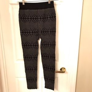Intricate gray and black patterned leggings